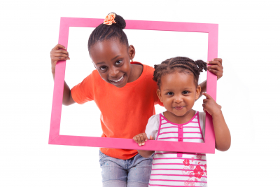 cute little girls holding a picture frame